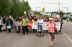 people walking on the road during the demonstration against Monsanto - stock photo
