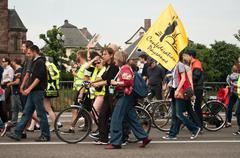 people protest on the road during the demonstration against Monsanto - stock photo
