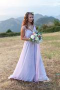 Attractive bride is holding a wedding bouquet Stock Photos