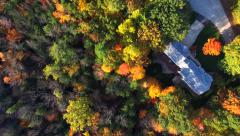 Looking Down on Autumn Forests with Houses Stock Footage