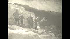 Vintage 16mm film, 1927, Canada, hikers mouth of ice cave Stock Footage