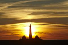 Westerhever (Germany) - Lighthouse at sunset - stock photo