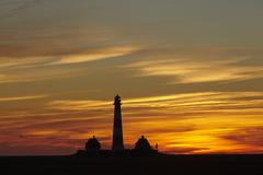 Westerhever (Germany) - Lighthouse in the evening - stock photo