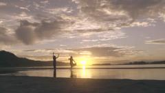 Two Young Women Dance And Twirl In Water At Sunset (4K) - stock footage