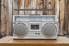 Vintage Boombox on Table with Rustic Cabin Wall - stock photo