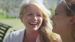 4K Close-up portrait of beautiful mother and daughter laughing together outdoors - stock footage