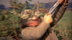 1973: Happy hunter simulating the shooting of birds in the air. Stock Footage