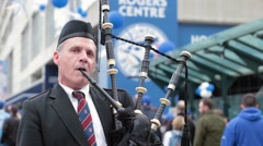 Bagpipes player outside rogers centre close up face Stock Footage
