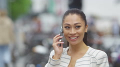 4K Portrait of beautiful young woman talking on mobile phone outdoors in city - stock footage