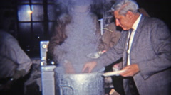 1965: Greedy man taking giant plate of oysters to eat. - stock footage