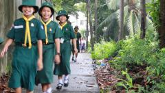 Thai Girl Scouts walking through a park in Thailand Stock Footage