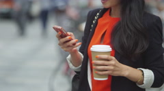 4K Portrait of beautiful young woman talking on mobile phone outdoors in city Stock Footage