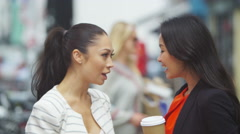 4K Beautiful female friends chatting & having fun outdoors in the city - stock footage
