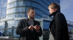Two young business man looking offer at their smartphone Stock Footage