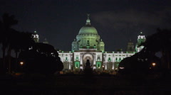 Victoria Memorial illuminated with changing lights at night, Kolkata, India Stock Footage