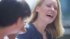 4K Portrait attractive female friends chatting & laughing outdoors in city - stock footage