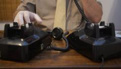 Man spy criminal on telephones places hand sets together in front of each other. Stock Footage