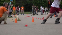Zoom out of unsuccessful skater ride with slalom element cone. 4K Stock Footage