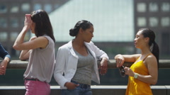 4K Attractive mixed ethnicity female friends chatting together outdoors in city - stock footage
