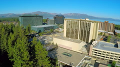 An aerial rising shot over casinos at South Lake Tahoe, Nevada. Stock Footage
