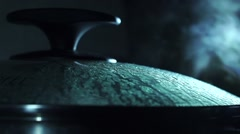 Steaming pan with glass cover low light closeup video - stock footage