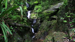 Man walk to waterfall take a picture by smartphone Stock Footage