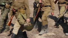 Soldiers In Uniform Of Soviet Army Marching On dusty Road. Stock Footage
