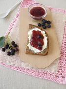 Bread with juneberry jam for breakfast Stock Photos