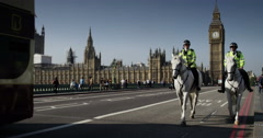 LONDON, UK - OCT 2015: Two policeman on the horse patrols at the London Bridge. Stock Footage
