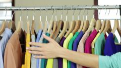 Woman's hand smoothing a colorful clothes HD Stock Footage