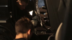 The guys dismantled the car for noise insulation - stock footage