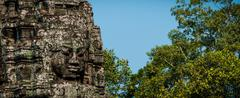 Head encarved in stone Bayon temple angkor - stock photo