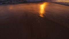 Beutiful Sandy Beach Sunset. Revealing Pan up from Sand to Sunset - stock footage