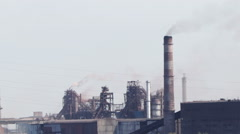The plant at the river, heavy industry, the smoke from pipes Stock Footage