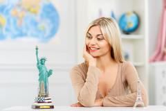 Pleasant girl planning her trip Stock Photos