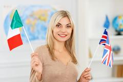 Nice girl preparing to travel - stock photo