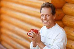 Pleasant man drinking tea - stock photo