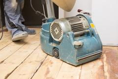 Restore the old plank floor with grinding machine Stock Photos