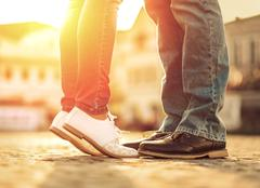 Couples foots stay at the street under sunlight - stock photo