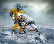 Ice hockey player on the ice Stock Photos