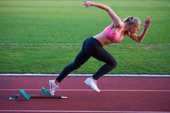 Stock Photo of pixelated design of woman  sprinter leaving starting blocks