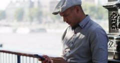 A stylish African American man using his cellphone in London. Shot on RED Epic. Stock Footage