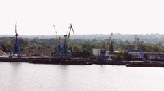 The work of a large crane in the river port Stock Footage