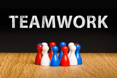 Concept for teamwork in business with white chalk text. Red white blue pawn f - stock photo