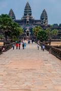 Path to Angkor Wat with people - stock photo
