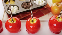 Handmade red candy apples for Halloween. - stock footage