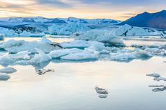 Scenic view of icebergs in glacier lagoon, Iceland Stock Illustration