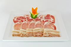 Assorted Fresh Cured Meats on white dish isolate - stock photo