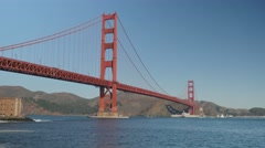 Navy Ship Passes Under Golden Gate Bridge  	 - stock footage