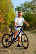 Mountain Bike cyclist riding outdoor - stock photo